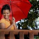 Black Woman Holding an Umbrella — Stock Photo #2896519