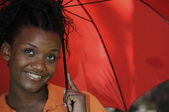 Black Woman Holding an Umbrella — Stock Photo