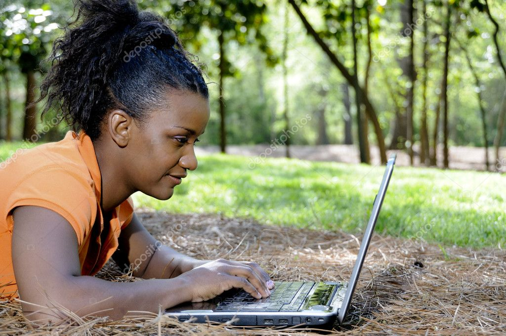 A college student working on a laptop — Stock Photo #2896048