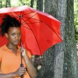 Black Woman Holding an Umbrella — Stock Photo #2909474