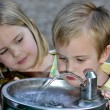 Foto Stock: Little Boy Drinking Water