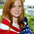 Stock Photo: Woman Wrapped in a Flag