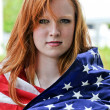 Foto de Stock  : Woman Wrapped in a Flag