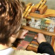 Stock Photo: Child Using Loom