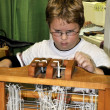 Child Using Loom — Stock Photo