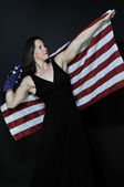 Woman Wrapped in a Flag — Stock Photo