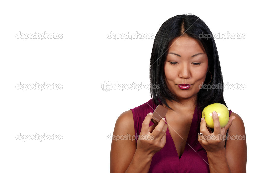 A woman trying to decide whether or not to eat healthy — Stock Photo #3871396