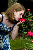Teenage Girl Smelling a Rose — Stock Photo