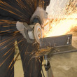 Stock Photo: Steel worker grinder