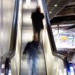 On escalator - Stock Photo