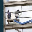 Window washers - Stock Photo