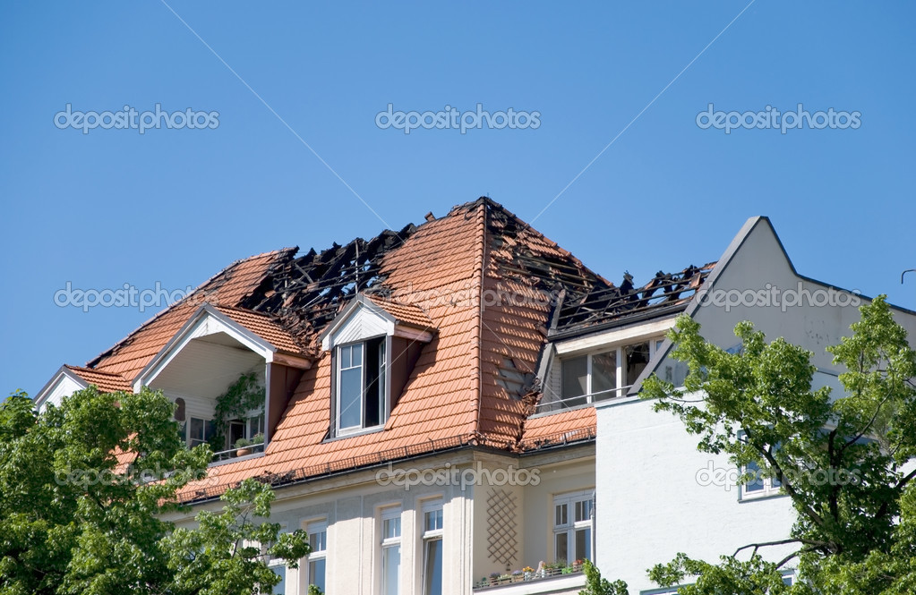 Day after a big fire in a roof of a house — Stock Photo #3295977