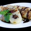 Rolled pancakes with poached pear — Stock Photo