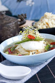 Chinese broth with poached egg — Stock Photo