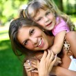 Sweet and beautiful girl with mom — Stock Photo #3568533