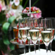 Champagne glasses on the table - Stock Photo
