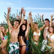 Стоковое фото: Happy teenagers playing at the sea