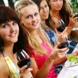 Group of beautiful girls drinking wine — Stock Photo #3589456