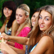 Group of beautiful girls drinking wine — Stock Photo #3589460