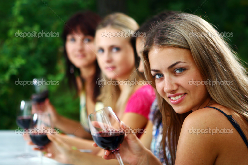 Group of beautiful woman drinking wine — Stock Photo #3589461