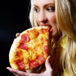 Beautiful woman eating fresh and tasty pizza — Stock Photo