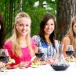 Group of beautiful girls drinking wine — Stock Photo #3670533