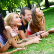 Stock Photo: Teenagers group in the park