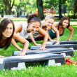 Stock Photo: Young and attractive girls doing fitness exercises