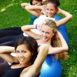 Young and attractive girls doing fitness exercises — Stock Photo