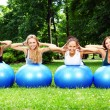 Young and attractive girls doing fitness exercises — Stock Photo #3670642