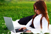 Young and beautiful girl doing home work — Stock Photo