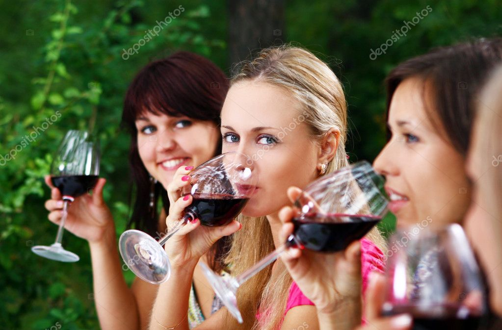 Group of beautiful woman drinking wine — Stock Photo #3670541