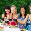 Group of young womens drinking wine — Stock Photo