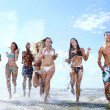 Happy teenagers playing at the sea — Stock Photo #3716640