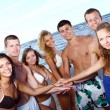 Happy teenagers playing at the sea — Stock Photo #3716930