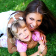 Beautiful little girl with her mother — Stock Photo #3760025