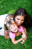 Beautiful little girl with her mother — Stock Photo