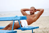 Attractive and happy man on beach — Stock Photo