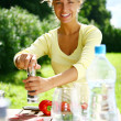 Smiling and beautiful woman cooking — Stock Photo