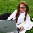 Stock Photo: beautiful young woman studing in park