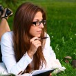 Beautiful young woman studing in park — Stock Photo #3827353
