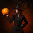Beautiful woman witha pumpkin in the hands — Stock Photo