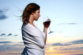 Beautyful young woman drinking wine on the beach — Stock Photo