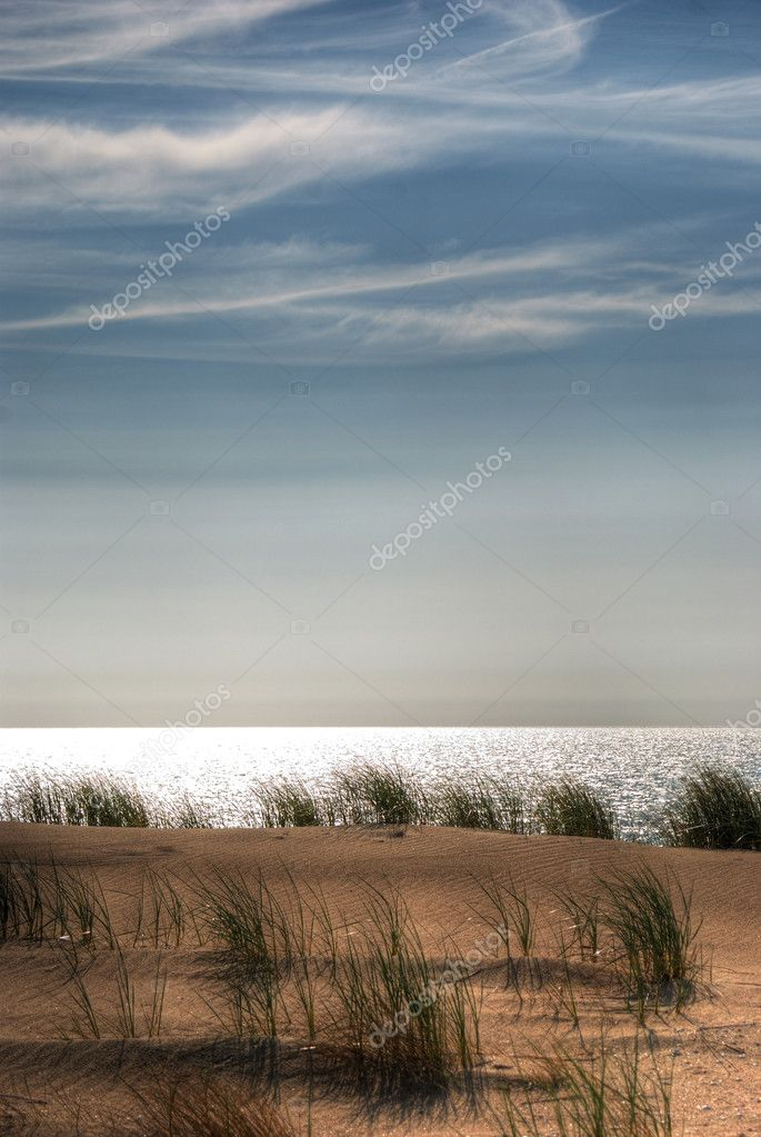 Dunes by the North sea under blue sky  Stock Photo #3433967