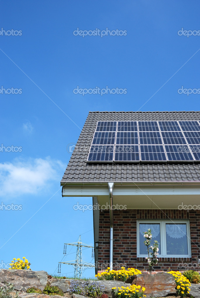 Roof with solar panel under cloudy sky — Stock Photo #3795102