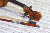 Violin head and bow — Stock Photo