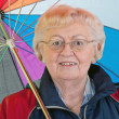 Elderly woman with umbrella — Stock Photo