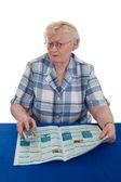 Senior woman watching TV — Stock Photo