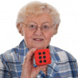 Senior woman with dice — Stock Photo