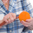 Peeling an orange — Stock Photo #3782286